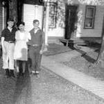 Lionel, Yo and  brother, Jean Guy in front of the family home in 1945.